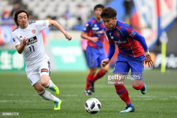 Kosuke Ota of FC Tokyo and Naoki Ishihara of Vegalta Sendai compete for the ball during the JLeague J1 match between FC Tokyo and Vegalta Sendai at...