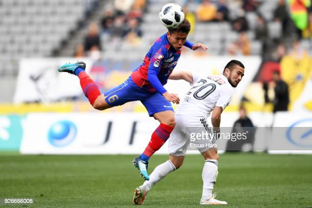 Kosuke Ota of FC Tokyo and Takuma Abe of Vegalta Sendai compete for the ball during the JLeague J1 match between FC Tokyo and Vegalta Sendai at...