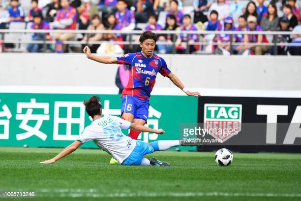 Kosuke Ota of FC Tokyo and Takuma Ominami of Jubilo Iwata compete for the ball during the JLeague J1 match between FC Tokyo and Jubilo Iwata at...