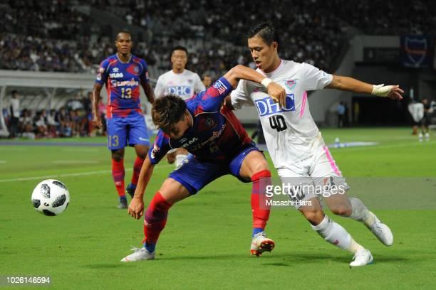 Kosuke Ota of FC Tokyo and Yuji Ono of Sagan Tosu compete for the ball during the JLeague J1 match between FC Tokyo and Sagan Tosu at Ajinomoto...
