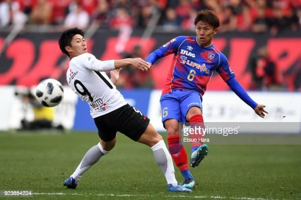 Kosuke Ota of FC Tokyo and Yuki Muto of Urawa Red Diamonds compete for the ball during the JLeague J1 match between FC Tokyo and Urawa Red Diamonds...