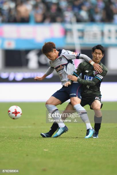 Kosuke Ota of FC Tokyo is challenged Riki Harakawa of Sagan Tosu during the JLeague J1 match between Sagan Tosu and FC Tokyo at Best Amenity Stadium...