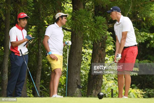 Kosuke Suzuki of Japan Eugenio LopezChacarra Coto of Spain and Frederik Korsgaard Sejr of Denmark chat during the third round of the Toyota Junior...
