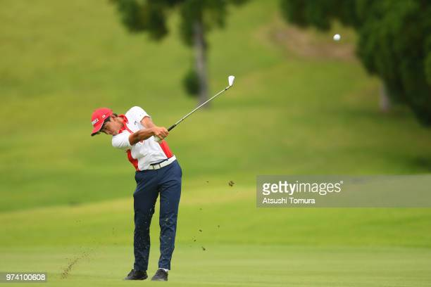 Kosuke Suzuki of Japan lines up his second shot on the 13th hole during the third round of the Toyota Junior Golf World Cup at Chukyo Golf Club on...
