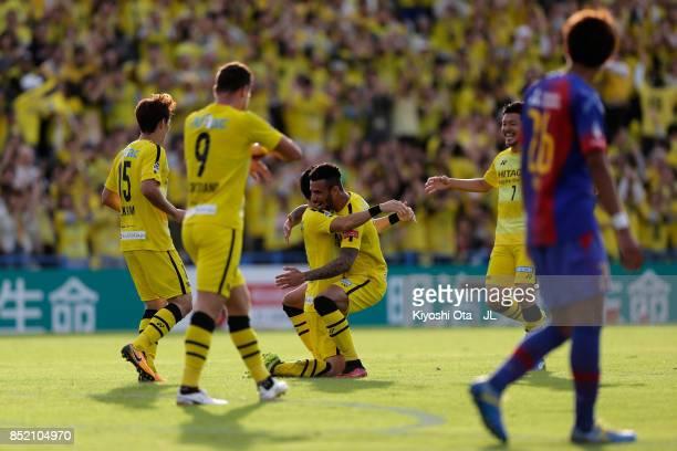 Kosuke Taketomi of Kashiwa Reysol celebrates scoring his side's first goal with his team mates during the JLeague J1 match between Kashiwa Reysol and...
