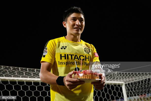 Kosuke Taketomi of Kashiwa Reysol is presented a birthday cake on his 27th birthday after the JLeague J1 match between Kashiwa Reysol and FC Tokyo in...