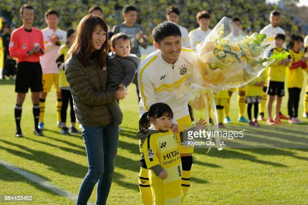 Kosuke Taketomi of Kashiwa Reysol poses for photographs at the ceremony marking his 100 appearances in the J1 prior to the JLeague J1 match between...