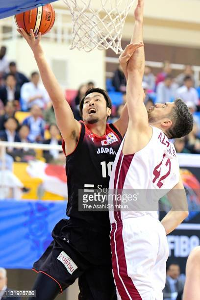Kosuke Takeuchi of Japan and Nasser Khalifa AlRayes of Qatar compete for the ball during the FIBA World Cup Asian Qualifier 2nd Round Group F match...