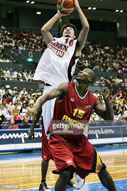 Kosuke Takeuchi of Japan drives to the basket against Angola during the preliminary round of FIBA World Championships 2006 on August 20 2006 in...