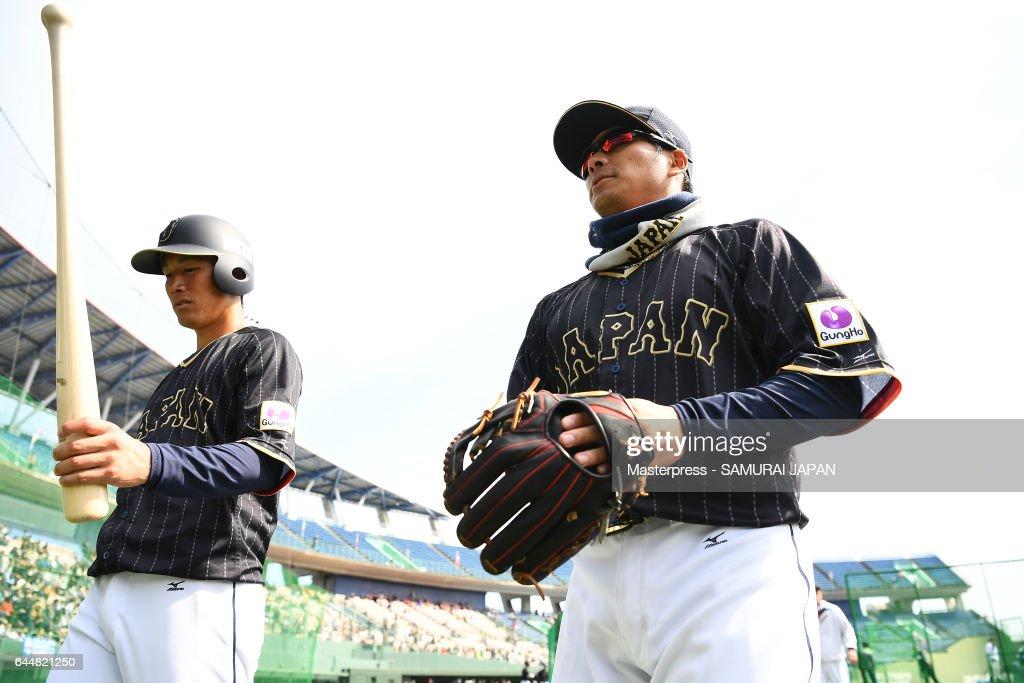 Kosuke Tanaka #2(R) of Japan looks on during SAMURAI JAPAN's training camp at the Sun Marine Stadium Miyazaki on February 24, 2017 in Miyazaki, Japan.