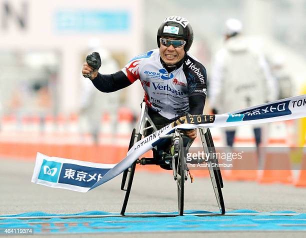 Kota Hokinoue of Japan celebrates as he wins the Men's Wheelchair race during the Tokyo Marathon 2015 at Tokyo Big Sight on February 22 2015 in Tokyo...