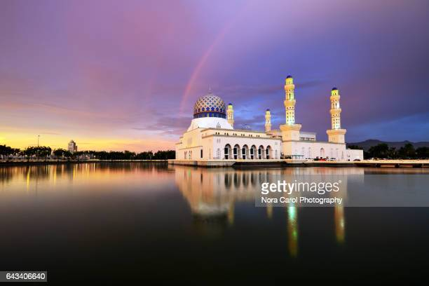 Kota Kinabalu city mosque qith rainbow during sunset.