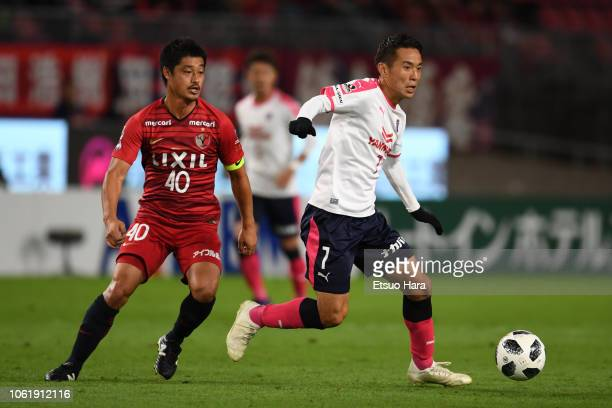 Kota Mizunuma of Cerezo Osaka and Mitsuo Ogasawara of Kashima Antlers compete for the ball during the JLeague J1 match between Kashima Antlers and...
