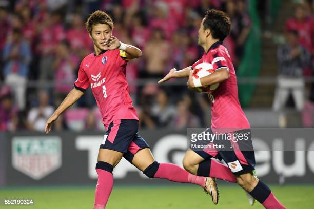 Kota Mizunuma of Cerezo Osaka celebrates scoring his side's first goal with his team mate Yoichiro Kakitani of Cerezo Osaka during the J.League J1...