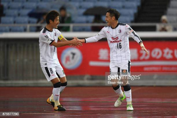 Kota Mizunuma of Cerezo Osaka celebrates scoring his side's second goal with his team mate Yoichiro Kakitani during the JLeague J1 match between...