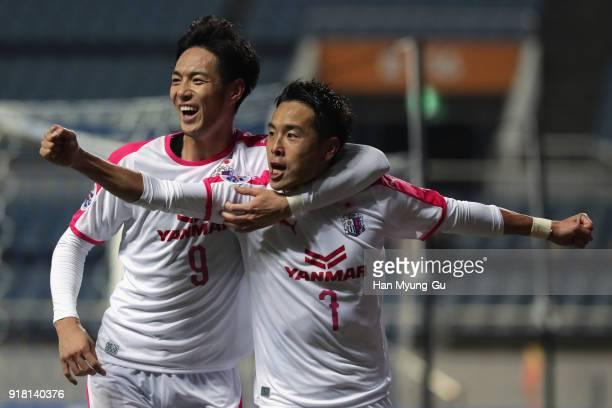 Kota Mizunuma of Cerezo Osaka celebrates scoring the opening goal with his team mate Kenyu Sugimoto during the AFC Champions League Group G match...