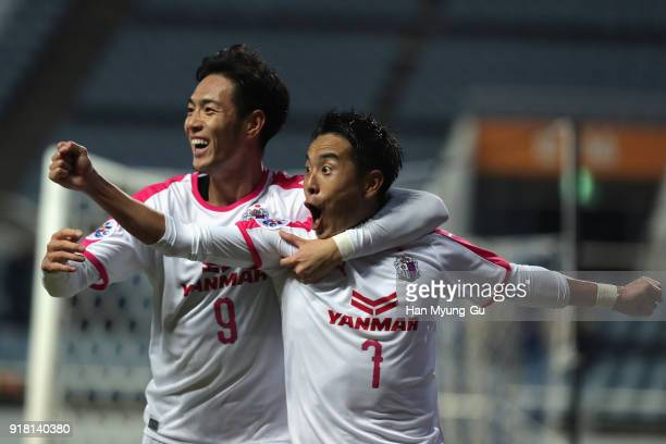 Kota Mizunuma of Cerezo Osaka celebrates scoring the opening goal with his team mate Kenyu Sugimoto during the AFC Champions League Group G match...