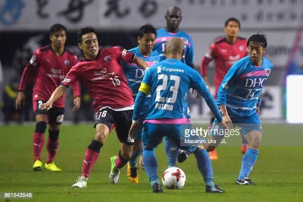 Kota Mizunuma of Cerezo Osaka takes on Yutaka Yoshida of Sagan Tosu during the JLeague J1 match between Sagan Tosu and Cerezo Osaka at Best Amenity...
