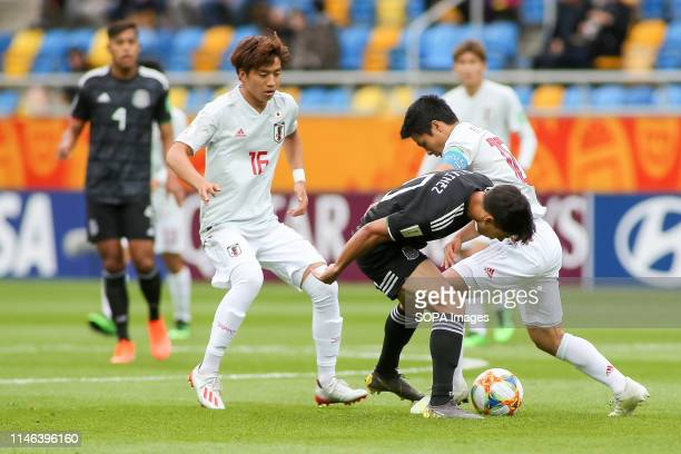 Kota Yamada Mitsuki Saito from Japan and Diego Lainez from Mexico are seen in action during the FIFA U20 World Cup match between Mexico and Japan in...