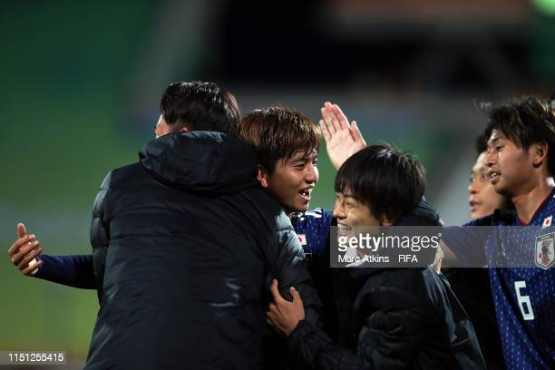 Kota Yamada of Japan celebrates with team mates after scoring during the 2019 FIFA U-20 World Cup group B match between Japan and Ecuador at...