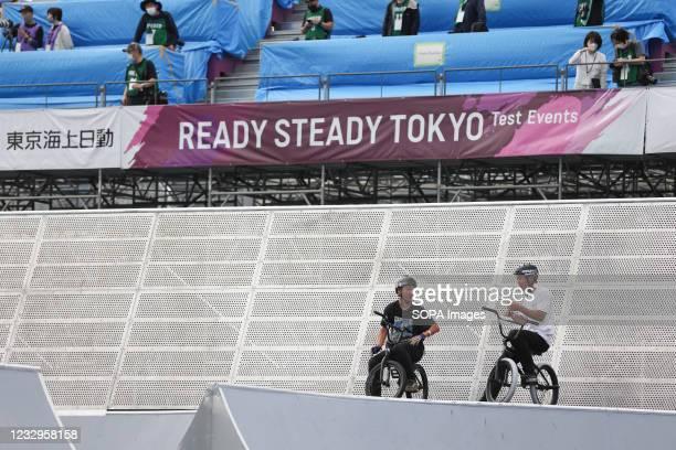 Kotaro Kaise talks to Joji Mizogaki during warm up for the first heat run at the Ready Steady Tokyo BMX Freestyle Olympic Test Event in Ariake Urban...