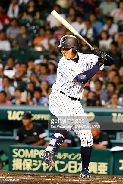 Kotaro Kiyomiya of Japan bats in the bottom half of the six inning in the sendoff game between U18 Japan and Collegiate Japan before the 2015 WBSC...