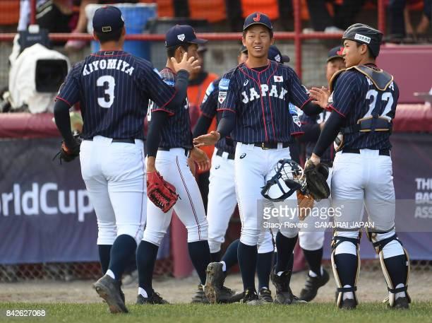 Kotaro Kiyomiya of Japan congratulates teammates after a victory over the Netherlands during the WBSC U18 Baseball World Cup Group B game between...