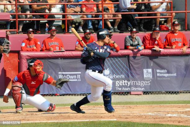 Kotaro Kiyomiya of Japan hits a RBI single in the 3rd inning during the WBSC U18 Baseball World Cup Bronze Medal Game between Japan and Canada at...