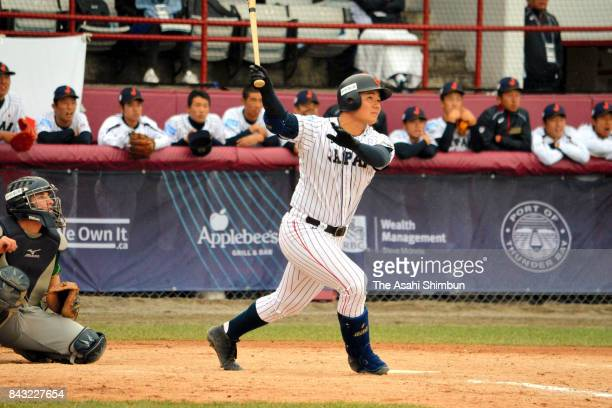 Kotaro Kiyomiya of Japan hits a solo homer in the fourth inning during the WBSC U18 Baseball World Cup Group B game between South Africa and Japan at...
