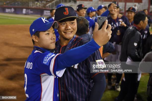 Kotaro Kiyomiya of Japan poses for a 'selfie' with Choi Jun Woo of Korea following the WBSC U18 Baseball World Cup medal ceremony at Port Arthur...