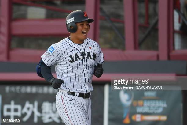 Kotaro Kiyomiya of Japan reacts to a solo home run during the fifth inning of a game against Canada during the WBSC U18 Baseball World Cup Super...