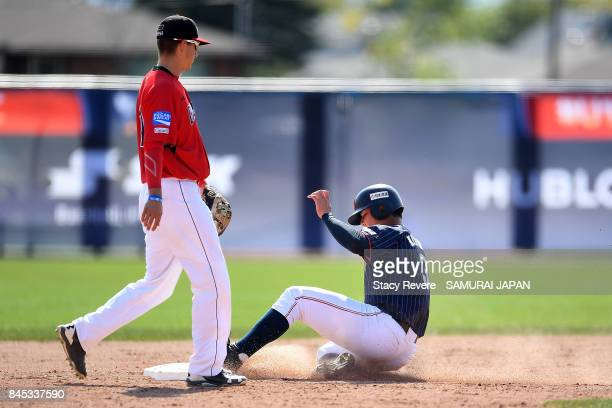 Kotaro Kiyomiya of Japan steals second base during the ninth inning of a game against Canada during the WBSC U18 Baseball World Cup Bronze Medal Game...