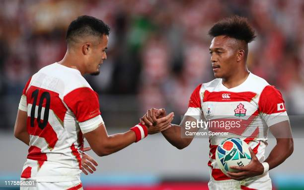 Kotaro Matsushima of Japan celebrates with teammate Yu Tamura after scoring his team's second try during the Rugby World Cup 2019 Group A game...