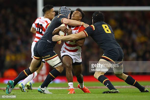 Kotaro Matsushima of Japan feels the force of James King and Jonathan Davies of Wales during the International match between Wales and Japan at the...