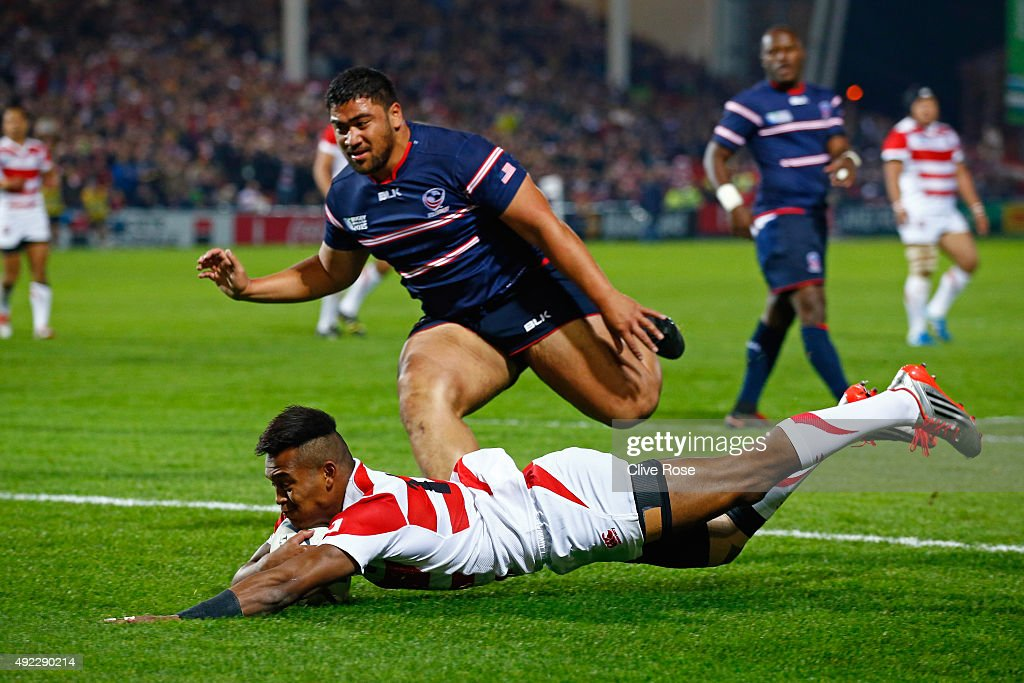Kotaro Matsushima of Japan goes over to score the opening try during the 2015 Rugby World Cup Pool B match between USA and Japan at Kingsholm Stadium on October 11, 2015 in Gloucester, United Kingdom.