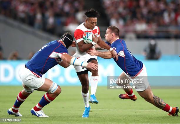 Kotaro Matsushima of Japan is tackled by Andrey Ostrikov of Russia and Vladimir Ostroushko of Russia during the Rugby World Cup 2019 Group A game...