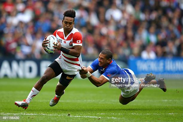 Kotaro Matsushima of Japan is tackled by Paul Perez of Samoa during the 2015 Rugby World Cup Pool B match between Samoa and Japan at Stadium mk on...