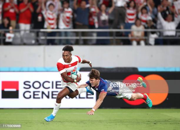 Kotaro Matsushima of Japan makes a break to score his side's fourth try during the Rugby World Cup 2019 Group A game between Japan and Russia at the...