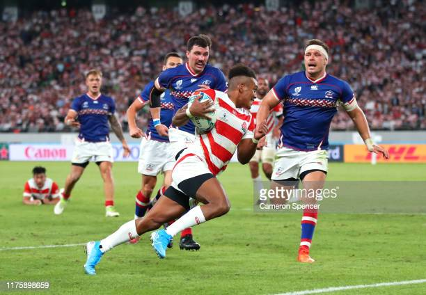 Kotaro Matsushima of Japan on his way to scoring his team's second try during the Rugby World Cup 2019 Group A game between Japan and Russia at the...