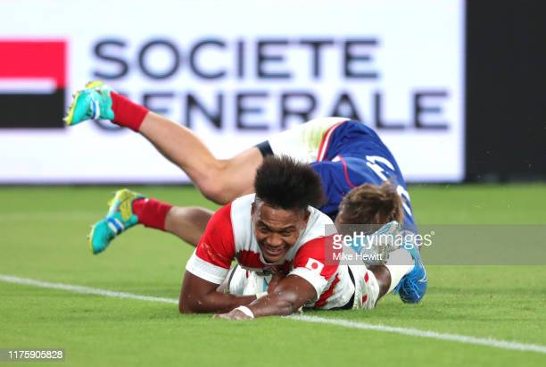 Kotaro Matsushima of Japan scores his team's fourth try during the Rugby World Cup 2019 Group A game between Japan and Russia at the Tokyo Stadium on...
