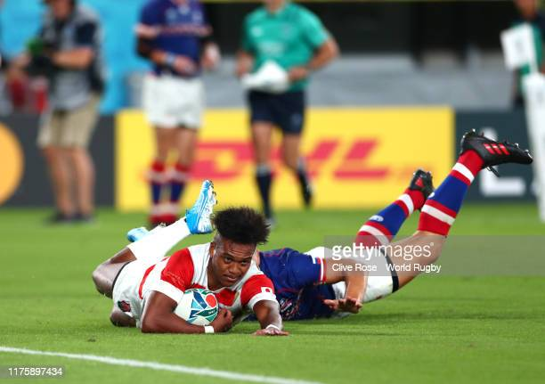 Kotaro Matsushima of Japan scores his team's second try during the Rugby World Cup 2019 Group A game between Japan and Russia at the Tokyo Stadium on...