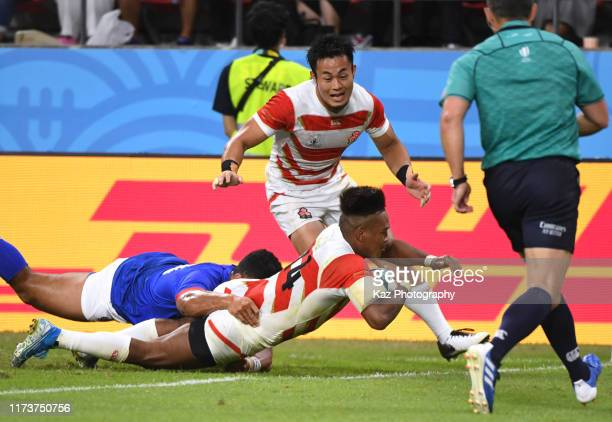 Kotaro Matsushita of Japan scores 4th try during the Rugby World Cup 2019 Group A game between Japan and Samoa at City of Toyota Stadium on October 5...