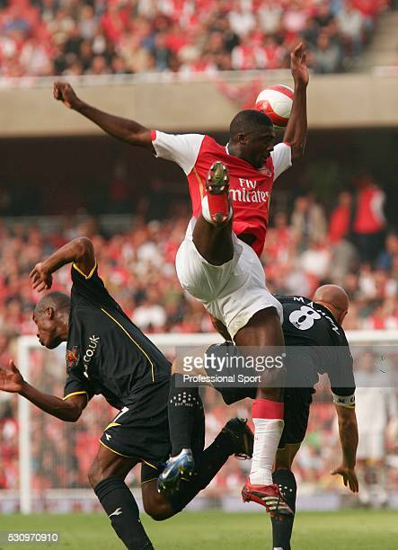 Koto Toure of Arsenal in action against Damien Francis and Gavin Mahon of Watford in a Barclays Premier League match at the Emirates Stadium London...