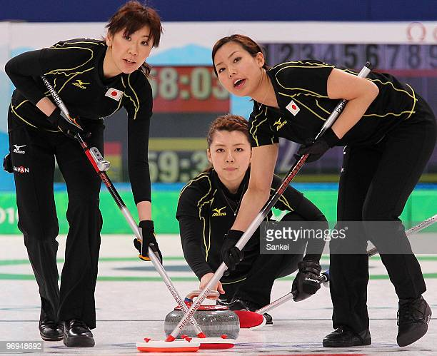 Kotomi Ishizaki, Mari Motohashi and Anna Ohmiya of Japan look on during the women's curling round robin game between Japan and Germany on day 10 of...