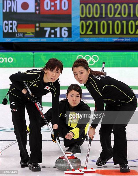 Kotomi Ishizaki, Moe Meguro and Mari Motohashi compete during the women's curling round robin game between Japan and Germany on day 10 of the...