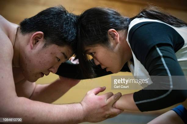 Kotone Hori a member of Asahi University's women's sumo team wrestles with a male opponent during a training session at the university sumo gym on...
