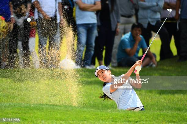 Kotone Hori of Japan chips onto the 17th green during the third round of the Suntory Ladies Open at the Rokko Kokusai Golf Club on June 10 2017 in...