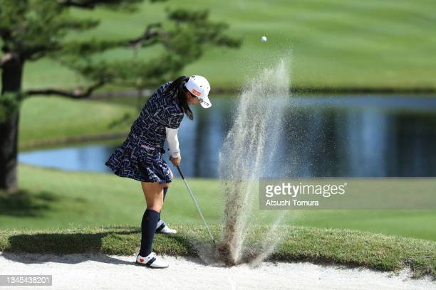 Kotone Hori of Japan hits her second shot out from a bunker on the 8th hole during the first round of the Stanley Ladies at Tomei Country Club on...