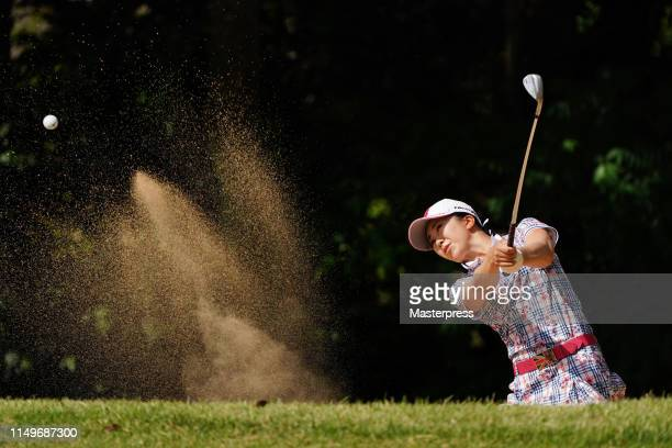 Kotone Hori of Japan hits out from a bunker on the 12th hole during the first round of the HokennoMadoguchi Ladies at Fukuoka Country Club Wajiro...