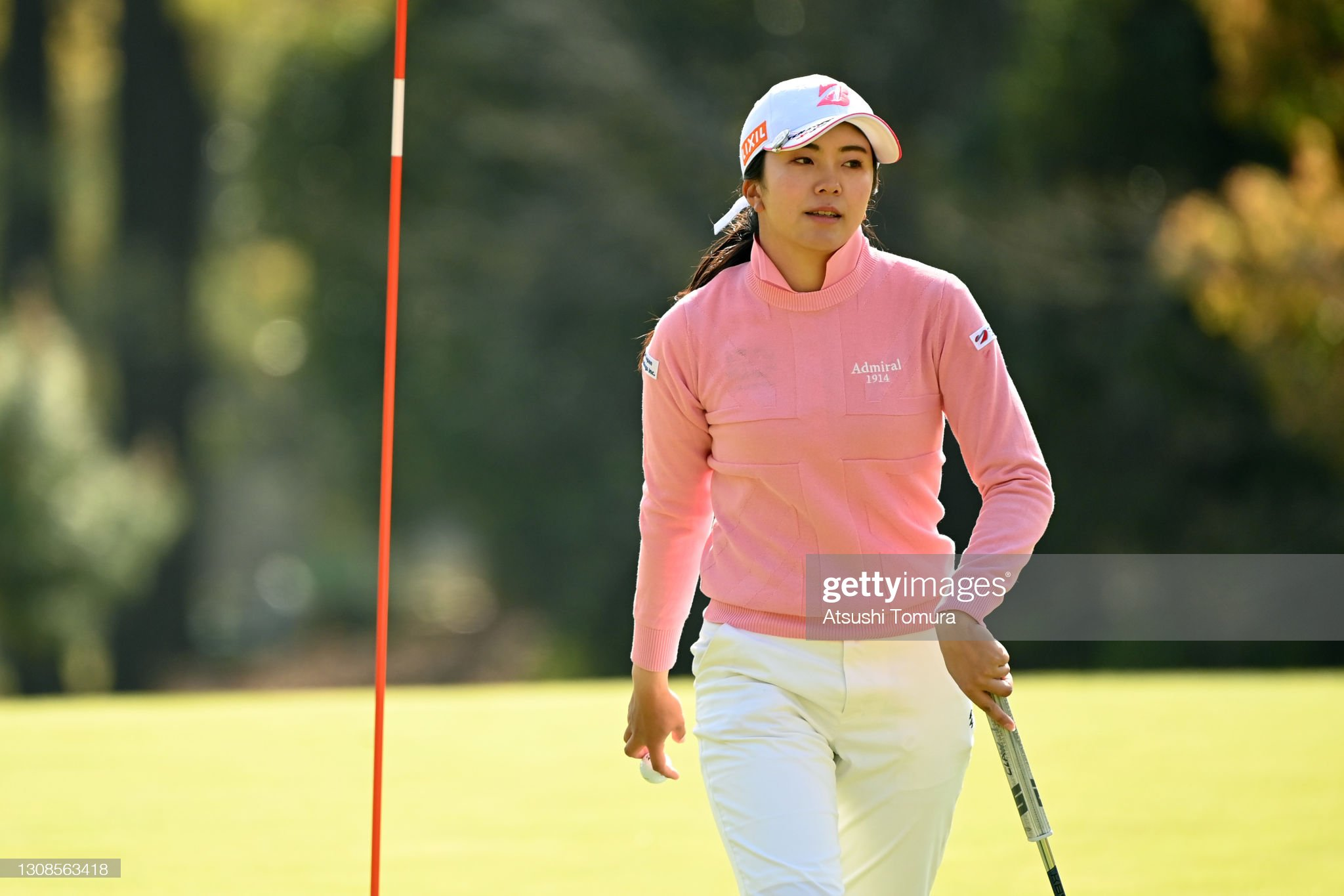 https://media.gettyimages.com/photos/kotone-hori-of-japan-is-seen-after-holing-out-on-the-18th-green-the-picture-id1308563418?s=2048x2048